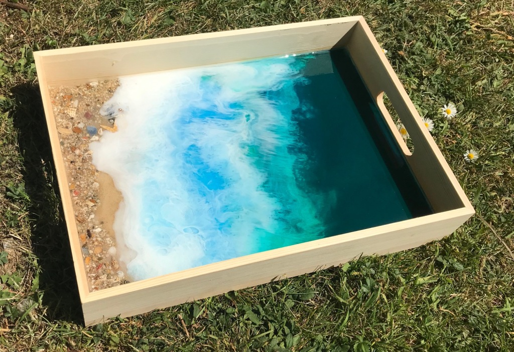 Serving tray with a resin seascape