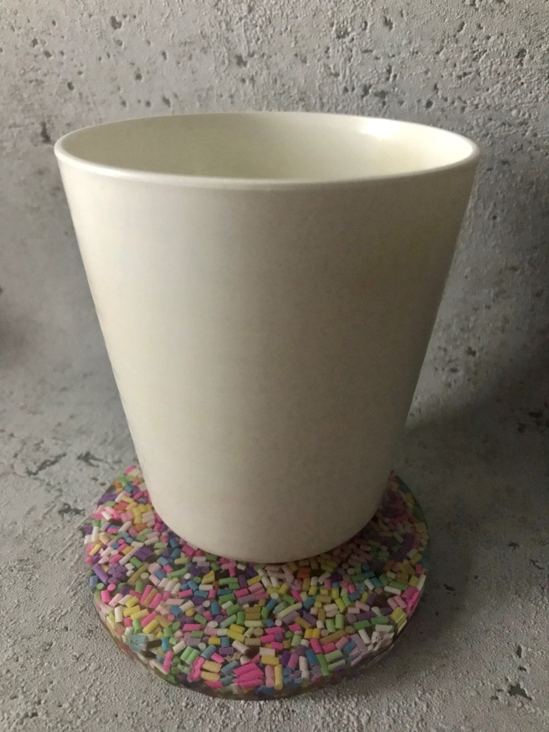 Polymer clay candy sprinkles coaster with a cup on top