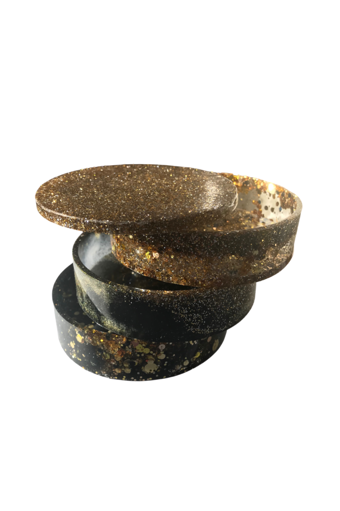 Resin jewellery box with three tiers and a lid with gold and black glitter