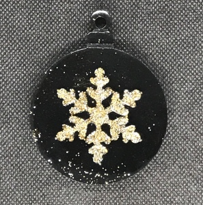 Resin black and gold snowflake in a bauble Christmas tree decoration