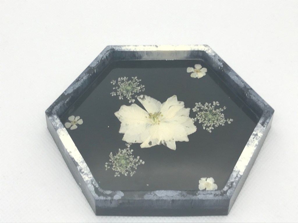 Hexagonal coaster with black and white alcohol ink and dried flowers